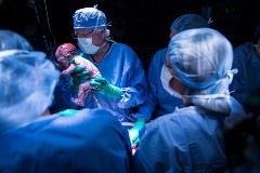 Dr Gunby and Johannesson delivering the baby